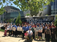 the ada legacy tour bus stands in front of the museum of natural sciences with excited members of the north carolina disability community